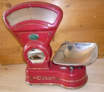 Red ASCO scales with Mrs O'Malley's branding.
