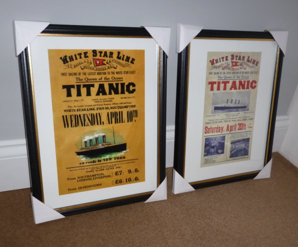 A pair of framed Titanic advertising posters